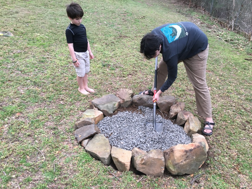 adding gravel to the fire pit for drainage